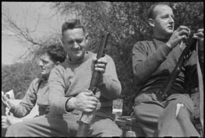 NZ frontline infantrymen cleaning rifles behind the lines on the Cassino Front, Italy, World War II - Photograph taken by George Kaye