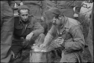 New Zealander C W Benson watches American C W Mann spot welding on 5th Army Front, Italy, World War II - Photograph taken by George Kaye
