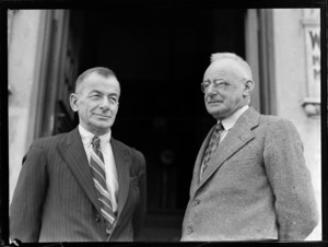 Portrait of (L to R) Vivian Walsh and Leo Walsh outside an unidentified building, Auckland