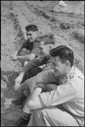 Three NZ Infantrymen resting behind the line after recent heavy fighting for Cassino, Italy, World War II - Photograph taken by George Kaye