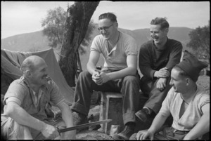 NZ Infantrymen chat while resting behind the line after heavy fighting on the Cassino Front, Italy, World War II - Photograph taken by George Kaye
