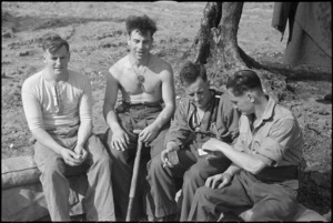 NZ Infantry personnel sit resting behind the line after heavy fighting in Cassino, Italy, World War II - Photograph taken by George Kaye