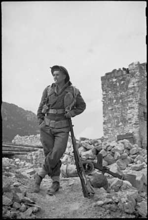 New Zealander J D Ruscoe leaning on his rifle on the Cassino battlefront, Italy - Photograph taken by George Kaye