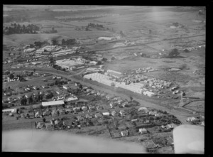 View of Hardies Fibrolite and NZ Forest Products' Pinex Factory, with Penrose Railway Station and Station Road East, Auckland