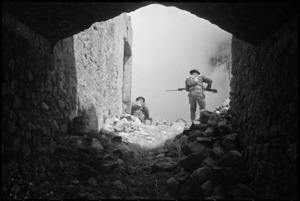 Soldiers moving through ruins on the Cassino battlefront, Italy - Photograph taken by George Kaye