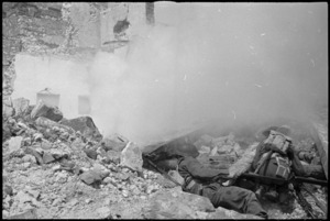 Soldiers use smoke screen on manoeuvres in the Cassino area, Italy - Photograph taken by George Kaye