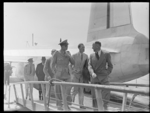 Lord Winster and members of his party, stepping off a Hobart flying boat, Mechanics Bay, Auckland