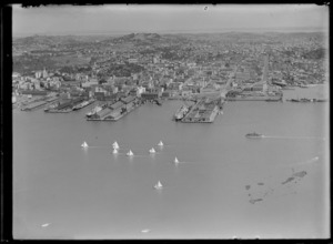 View of Auckland City and waterfront with wharves, cargo ships and yachts, Mount Eden beyond