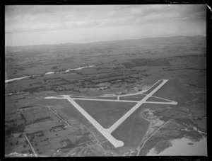 Whenuapai Airfield with runways surrounded by farmland, Auckland