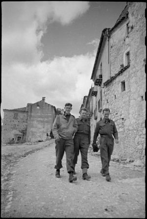 Three New Zealanders in an Italian village near the Italian battlefront, World War II - Photograph taken by George Kaye