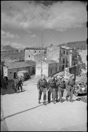 New Zealanders stroll through typical village on the Italian Front, World War II - Photograph taken by George Kaye
