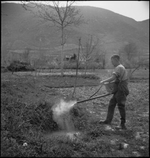 D Brown uses the 'dust gun' at the New Zealand Malarial School in the Volturno Valley, Italy, World War II - Photograph taken by M D Elias