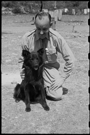 Major F Hutter with Butch, the canine mascot of 6 NZ Field Ambulance, Italy, World War II - Photograph taken by George Bull