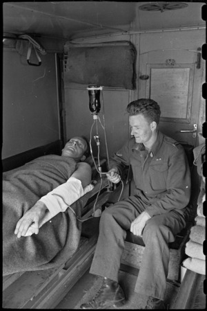 Blood transfusion apparatus for moving ambulances demonstrated by J R A Chote and R N E Taylor, Italy, World War II - Photograph taken by George Bull