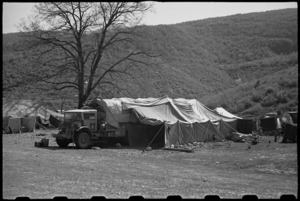Tarpaulin lean to used as an operating theatre at 6 NZ Field Ambulance Unit in Italy, World War II - Photograph taken by George Bull