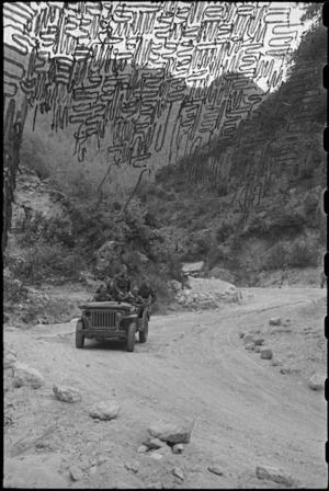 Camouflage nets strung across part of the Inferno Track, Cassino area, Italy, World War II - Photograph taken by George Bull