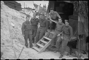 Group of New Zealanders at HQ of 5 NZ Infantry Brigade at Hove Supply Dump, Cassino area, Italy - Photograph taken by George Bull
