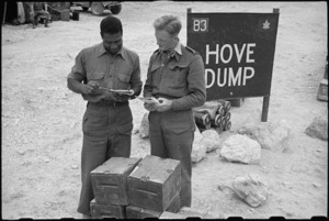 Sergeant J Byer and Sergeant Coventry check out supplies at Hove Dump, Cassino area, Italy, World War II - Photograph taken by George Bull