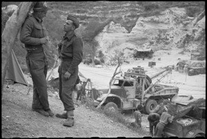 C Hoskins and D Kenny in general view of the Recovery Section at Hove Dump, Cassino area, Italy, World War II - Photograph taken by George Bull