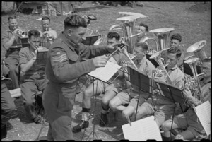 Tenor horn and base sections of 6 NZ Infantry Brigade Band playing under conductorship of Staff Sergeant F Sykes, Italy, World War II - Photograph taken by George Bull