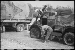 R F Skews and J Ball wash their trucks in the Volturno River, Italy, World War II - Photograph taken by George Bull
