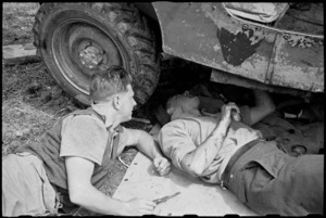 G R Wilmer and M Phillips repair their jeep in the Volturno Valley, Italy, World War II - Photograph taken by George Bull