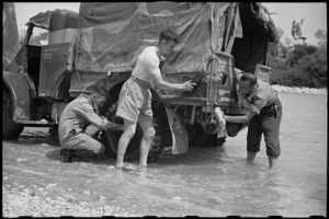 New Zealanders wash their truck in the Volturno River, Italy, World War II - Photograph taken by George Bull