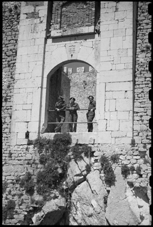 New Zealand troops on leave stand in the old gateway to the castle of Campobasso, Italy, World War II - Photograph taken by George Bull