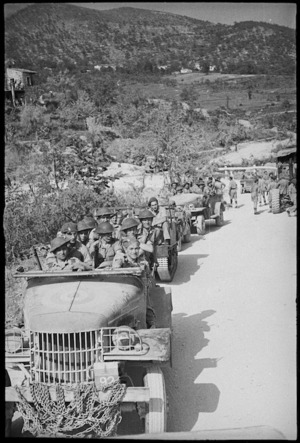 Infantrymen advance in transports to the forward area as Allies advance past Cassino, Italy, World War II - Photograph taken by George Kaye
