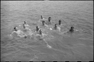 New Zealanders at 1 NZ Convalescent Depot enjoy a swim at Santo Spirito, Italy, World War II - Photograph taken by George Bull