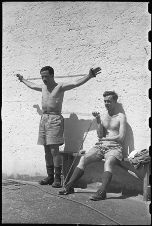 M Wineere and S M Toms using springs for remedial exercises at 1 NZ Convalescent Depot at Santo Spirito, Italy, World War II - Photograph taken by George Bull