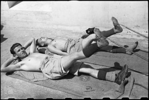 F J G Waller and A E Latimer doing remedial leg exercises at 1 NZ Convalescent Depot at Santo Spirito, Italy, World War II - Photograph taken by George Bull