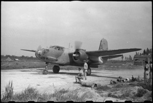 Night bomber on an aerodrome warming up for a test flight, Caserta, Italy, World War II - Photograph taken by George Bull