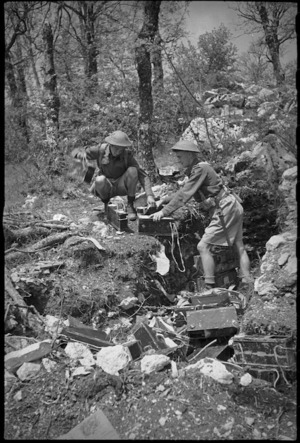 K A Jacobs and R W North collecting ammunition from a pit on 8th Army Front, Italy, World War II - Photograph taken by George Kaye