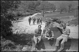 NZ Engineers with bulldozer on a road they helped build in hilly country on the Cassino Front, Italy, World War II - Photograph taken by George Kaye