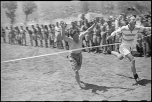 J P Gordon winning the 880 yards race at 5 NZ Infantry Brigade Sports Meeting in Italy, World War II - Photograph taken by George Kaye
