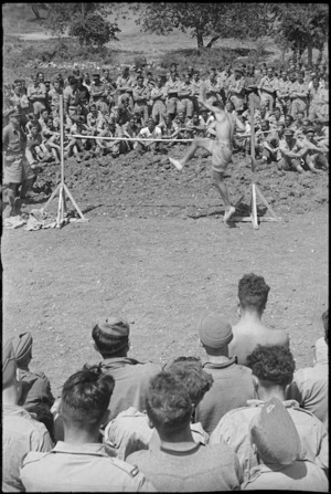 Competitor taking part in the high jump at 5 NZ Infantry Brigade Sports Meeting in Italy, World War II - Photograph taken by George Kaye