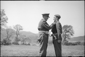 T/Major V J Tanner receiving the DSO from General Freyberg, Volturno Valley, Italy, World War II - Photograph taken by George Kaye