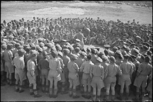 NZ troops grouped around Prime Minister Peter Fraser during visit to the Cassino area, Italy - Photograph taken by George Robert Bull
