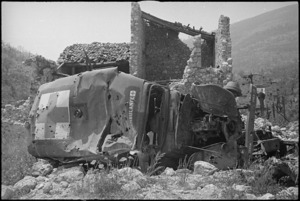 Wrecked ambulance lies outside the ruins of Cassino, Italy - Photograph taken by George Kaye
