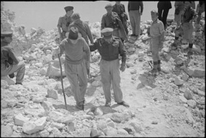 Prime Minister Peter Fraser and General Bernard Freyberg in conversation in ruins of Abbey Cassino, Italy, World War II - Photograph taken by George Kaye