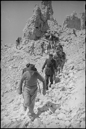 Prime Minister Peter Fraser leads his party among the ruins of the monastery at Cassino, Italy, World War II - Photograph taken by George Kaye