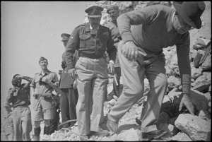 Prime Minister Peter Fraser, followed by General Bernard Freyberg, clambers over ruins of Cassino Monastery, Italy, World War II - Photograph taken by George Kaye