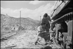NZ tank recovery men salvaging a tank in Cassino, Italy, World War II - Photograph taken by George Kaye