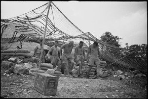 Gunners of NZ Divisional Artillery leaving gun pit after a shoot in the Cassino area, Italy, World War II - Photograph taken by George Kaye