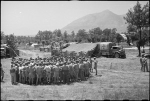 General view of Prime Minister Peter Fraser talking to personnel of 4 NZ Field Ambulance near Casino, Italy, World War II - Photograph taken by George Bull