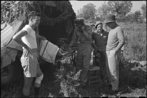 Prime Minister Peter Fraser meeting personnel of 19 NZ Armoured Regiment at St Elia, Italy, World War II - Photograph taken by George Bull