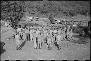 NZ Prime Minister Peter Fraser talking to 6 NZ Field Ambulance personnel in Volturno Valley, Italy, World War II - Photograph taken by George Bull