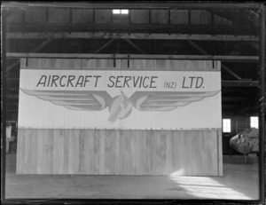 Aircraft Service Limited signboard within an aeroplane hangar, Mangere Airfield, Auckland
