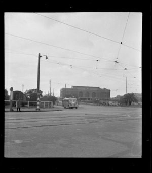 View of Johnston's Airways Transport Kiwi 2 bus leaving Auckland Railway Station for Mangere Airfield